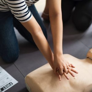 person practicing cpr